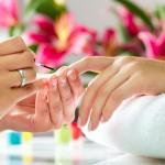 bigstock-Woman-in-a-nail-salon-receivin-37087198